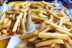 French fries on a paper plate royalty free stock photos