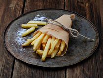 French fries in paper wrapper Stock Photos