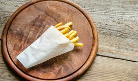 French fries in a paper wrapper Stock Image
