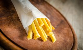 French fries in a paper wrapper Royalty Free Stock Images