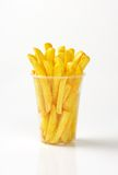 French fries. Plastic cup of french fries on white background Royalty Free Stock Images