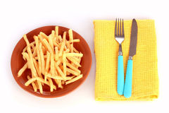French fries on a plate and cutlery isolated Stock Images