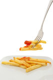 French fries on plate and fork Stock Image