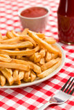 French fries on plate with ketchup Stock Image