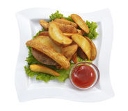 French fries on plate with ketchup and lettuce Royalty Free Stock Photos