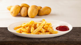 French fries on a plate and sauce Stock Photos