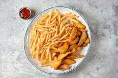 French fries -  potato stick and potato wedges in hot bread. Top view. Copy space. French fries - potato stick and potato wedges in hot bread. Top view. Copy Royalty Free Stock Photos