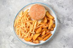 French fries -  potato stick and potato wedges in hot bread. Top view. Copy space. French fries - potato stick and potato wedges in hot bread. Top view. Copy Stock Photo