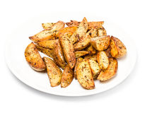 French fries potato wedges in country styled with spices on a pl Stock Photos