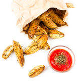 French fries potato wedges with hot red  sauce in recycled kraft Royalty Free Stock Photos