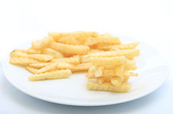 French fries potatoes stack on white dish Stock Photography