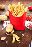 French fries in red paper bag. Royalty Free Stock Photography