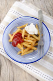 French fries red and white on a plate Stock Photos