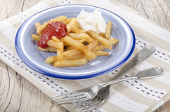 French fries red and white on a plate Royalty Free Stock Photo