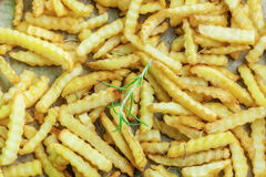 French fries with rosemary on paper Royalty Free Stock Photo