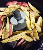French fries and sausages cooking Royalty Free Stock Images