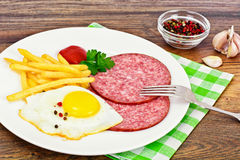 French Fries with Scrambled Eggs, Ham, Ketchup Stock Image