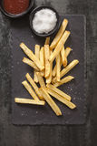 French Fries with Sea Salt on Black Slate Stock Photography