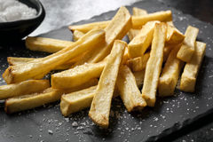 French Fries with Sea Salt on Black Slate Stock Images
