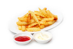 French fries. Served with chili sauce and mayonnaise Royalty Free Stock Photo