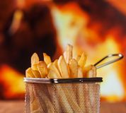 French fries served in metallic mesh basket stock photo