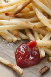 French Fries. Served with salt and ketchup stock images
