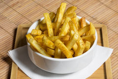 French fries served in white bowl Royalty Free Stock Photos