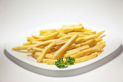 French Fries. Served on white plate, decorated with a branch of parsley Stock Images
