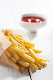 French fries. And souce on white wooden table Royalty Free Stock Image