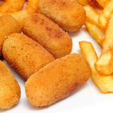 French fries and spanish croquettes Stock Image
