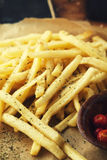 French fries with spices. And pickled hot peppers Stock Photos