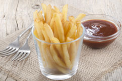 French fries and spicy tomato sauce Royalty Free Stock Images