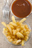 French fries and spicy tomato sauce Royalty Free Stock Photos