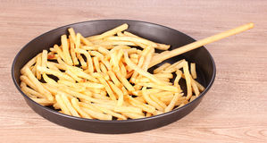French fries and spoon in the pan Royalty Free Stock Photography