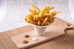 French fries. Sprinkled with salt and pepper Stock Images