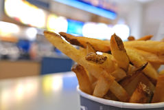 French fries on table at food court area. Close up french fries on table at food court area Royalty Free Stock Photography