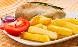 French fries, tomato, chicken fillets Stock Image