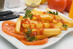 French fries with tomato and ketchup Royalty Free Stock Image