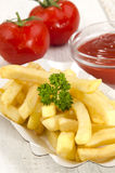 French fries and tomato ketchup Royalty Free Stock Images