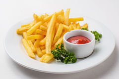 French fries with tomato sauce. On a white background Royalty Free Stock Photography