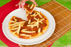 French fries toppin pizza Stock Photo