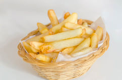 French fries. Traditional French fries in a bamboo basket Stock Photography