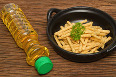 French fries with Vegetable oil Royalty Free Stock Photo