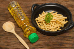 French fries with Vegetable oil Stock Photo