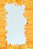 French fries on white background. Top view of french fries on white background Royalty Free Stock Image