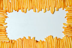 French fries on white background. Top view of french fries on white background Stock Images