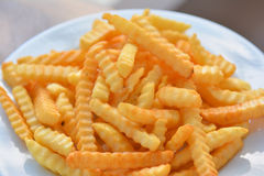 French Fries on white dish Royalty Free Stock Images