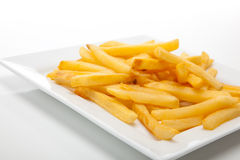 French fries on a white plate Royalty Free Stock Images