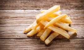 French Fries on Wood Background Stock Photos