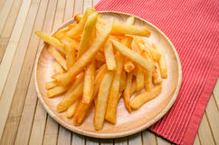 French fries on wood plate Stock Photo